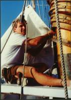 Lashing on new sails July 1991 Tribune Bay